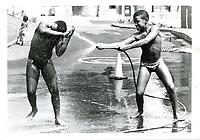 2 jeunes garcons se rafraichissent durant la vague de chaleur, aout 1987 (date exacte inconnue)<br /> <br /> PHOTO :  Pierre Roussel<br />  - Agence Quebec Presse