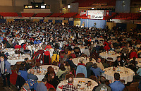 Thursday March 2, 2006  Anchorage, Alaska   Race fans watch as mushers tell the crowd of their chosen starting postion at the musher's pre-race drawing and banquet, the largest banquet in Alaska at the Eagan Center.