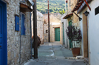 Stock image of a narrow street of Omodos,ancient old village with old fashioned stone houses in Cyprus situated in Troodos mountains.