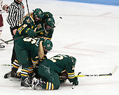 Cassidy Campeau (UVM - 18), Daria O'Neill (UVM - 77), Bridget Baker (UVM - 16), Amanda Drobot (UVM - 12) -  The Boston College Eagles defeated the University of Vermont Catamounts 4-3 in double overtime in their Hockey East semi-final on Saturday, March 4, 2017, at Walter Brown Arena in Boston, Massachusetts.