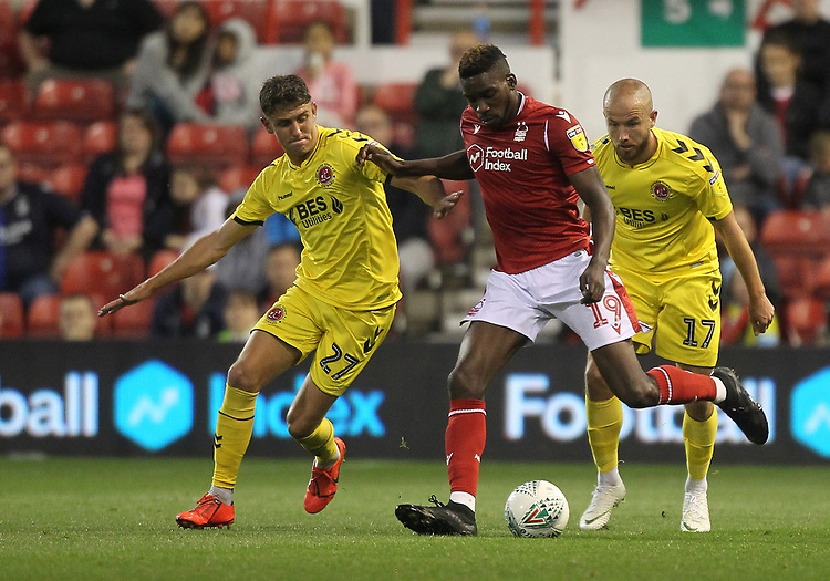 Fleetwood Town's Harrison Biggins battles with Nottingham Forest's Sammy Ameobi <br /> <br /> Photographer Mick Walker/CameraSport<br /> <br /> The Carabao Cup First Round - Nottingham Forest v Fleetwood Town - Tuesday 13th August 2019 - The City Ground - Nottingham<br />  <br /> World Copyright © 2019 CameraSport. All rights reserved. 43 Linden Ave. Countesthorpe. Leicester. England. LE8 5PG - Tel: +44 (0) 116 277 4147 - admin@camerasport.com - www.camerasport.com