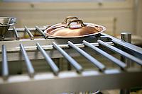 Copper saucepan lids sit on a rack at the Ecole Superieure de Cuisine Francaise Gregoire Ferrandi cooking school in Paris, France, 18 December 2007.
