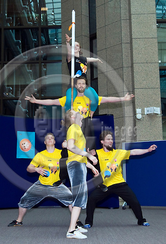 BRUSSELS  -  BELGIUM  - 19 MAY 2011 -- Turku (Finland), the European Capital of Culture 2011 bringing circus greetings to the EU-Institutions in Brussels -- Five students, (Mika Formunen, Pyry Kääriä, Jukka Haataja, Saana Nissinen Toivo Kautto and the Estonian guitarist Dimitir Timoshenko) of the Performing Arts Circus line at Turku Arts Academy preforming at the EU-Council. -- PHOTO: Juha ROININEN / EUP-Images.