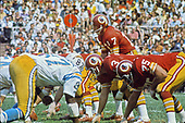 Washington Redskins quarterback Billy Kilmer (17) calls signals during the game against the San Diego Chargers at RFK Stadium in Washington, DC on September 16, 1973.  Pictured are Redskins left tackle Terry Hermeling (75) and left guard Paul Laaveg (73) and Chargers defensive end Lionel Aldridge (87).  The Redskins won the game 38 - 0.<br /> Credit: Arnie Sachs / CNP