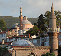 Rooftops and minarets in the town of Bursa, Turkey, with the Green Mosque or Yesil Cami in the distance. The Green Mosque was built under Sultan Mehmed Celebi in 1419-21 by the architect Haci Ivaz Pasha. The painted decorations were by Ali bin Ilyas and Mehmed el Mecnun. Following an earthquake in 1855, the building underwent an extensive renovation led by architect Leon Parvillee. Picture by Manuel Cohen