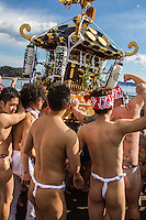 Enoshima Koshogatsu Matsuri Mikoshi -  Koshigatsu or Little New Year celebrates the first full moon of the new year on the 15th day of January. The main events of Koshogatsu are rites and practices praying for a bountiful harvest, and rice gruel with azuki beans or bean paste  is traditionally eaten in the morning. New Year decorations are taken down and burnt at the local Shinto shrine (they are normally never re-used for the following year).  One of the more popular activities is organized by local shinto shrines, involving a winter matsuri festival. Local men carry the mikoshi portable shrine into the ocean after firing themselves up with sake, then bring the mikoshi back to the shrine.  This ritual is most famously celebrated in Enoshima, near Kamakura, which draws thousands of spectators to the beach to participate in and watch the fundoshi loincloth men carry the mikoshi into the ocean, and back again.  It is a form of ritual cleansing and a way to brace onself for the new year.
