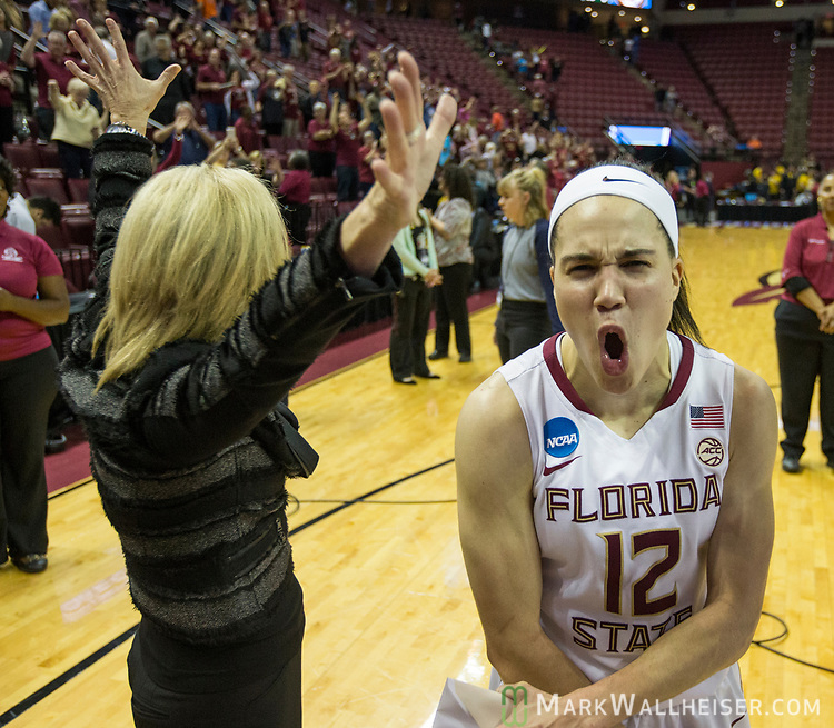 Florida State head coach Sue Semrau, left, and Florida State guard Brittany Brown celebrate defeating Missouri in a second-round game of the NCAA women's college basketball tournament in Tallahassee, Fla., Sunday, March 19, 2017. Florida State defeated Missouri 77-55. (AP Photo/Mark Wallheiser)