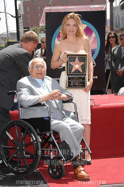 Michelle Pfeiffer & Hollywood honorary mayor Johnny Grant on Hollywood Blvd where she was honoured with the 2,345th star on the Hollywood Walk of Fame..August 6, 2007  Los Angeles, CA.Picture: Paul Smith / Featureflash