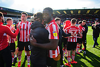 Lincoln City's assistant manager Nicky Cowley hug Lincoln City's John Akinde as they celebrate securing promotion from Sky Bet League Two<br /> <br /> Photographer Chris Vaughan/CameraSport<br /> <br /> The EFL Sky Bet League Two - Lincoln City v Cheltenham Town - Saturday 13th April 2019 - Sincil Bank - Lincoln<br /> <br /> World Copyright © 2019 CameraSport. All rights reserved. 43 Linden Ave. Countesthorpe. Leicester. England. LE8 5PG - Tel: +44 (0) 116 277 4147 - admin@camerasport.com - www.camerasport.com