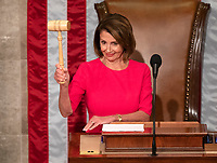 Speaker of the United States House of Representatives Nancy Pelosi (Democrat of California) shows off the gavel after accepting it from United States House Minority Leader Kevin McCarthy (Republican of California) as the 116th Congress convenes for its opening session in the US House Chamber of the US Capitol in Washington, DC on Thursday, January 3, 2019. Photo Credit: Ron Sachs/CNP/AdMedia