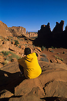 Boy in yellow sweatshirt along Park Avenue-Arches National Park, Utah