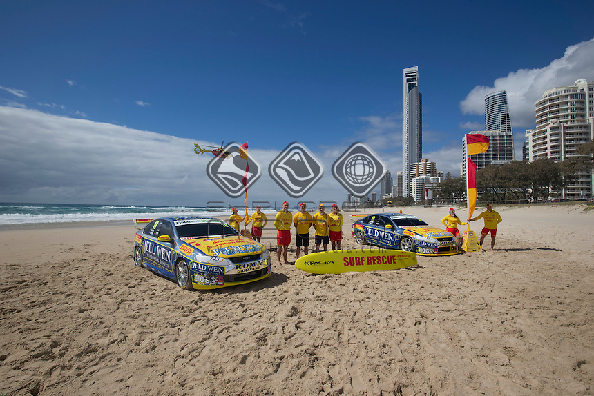 V8 Supercars drivers Jack Perkins and Cameron Waters join Surf Life Saving Queensland, Perkins and Waters take their V8 Supercar on the beach with the SLSQ team <br /> Castrol EDGE GC600, Event 12 of the 2014 Australian V8 Supercar Championship Series at Gold Coast Street Circuit, Gold Coast, October 22, 2014.&copy; Sport the library / Edge Photographics
