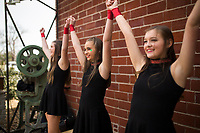 NWA Democrat-Gazette/CHARLIE KAIJO Dancers Eden Snyder 14 (from left), Kristin Campbell 13 and Audra Graves 15 finish their Irish dance performance, Saturday, March 17, 2018 at The Forge in Bentonville. <br />