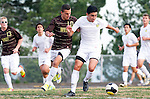 Palos Verdes, CA 01/22/13 - Oscar Chacon (Peninsula #8) and Joseph Barakat  (West Torrance #10) in action during the West vs Peninsula boys varsity soccer game at Peninsula High School.