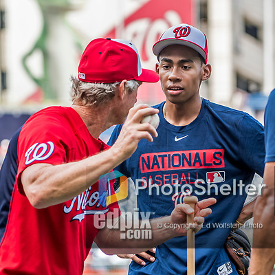 8 July 2017: Washington Nationals Manager's son Darren Baker listens to coaching tips from Bench Coach Chris Speier after batting practice prior to a game against the Atlanta Braves at Nationals Park in Washington, DC. The Braves shut out the Nationals 13-0 to take the third game of their 4-game series. Mandatory Credit: Ed Wolfstein Photo *** RAW (NEF) Image File Available ***