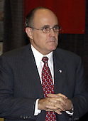 Former New York City Mayor Rudy Giuliani meets reporters at the McGraw Hill Companies' Homeland Security Summit and Exposition in Arlington, Virginia on May 14, 2003..Credit: Ron Sachs / CNP