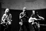MIAMI, FL - MAY 04:  (Exclusive Coverage) (EDITORS NOTE: Image has been converted to black and white.) Guitarist Miki Ramirez, Vocalist Daniel 'Mono Loco' Carbonell and guitarist Tomas Tirtha Rundquist of musical band Macaco Performs and pose for portrait during Sony Music Latin album showcase on May 4, 2015 in Miami, Florida.  ( Photo by Johnny Louis / jlnphotography.com )