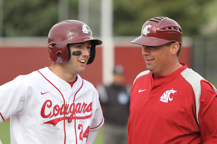 Washington State junior outfielder, Garry Kuykendall (#24), talks with head coach Donnie Marbut during the Cougars Pac-10 conference baseball game against Oregon State at Bailey-Brayton Field in Pullman, Washington, on April 24, 2010.