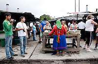 A Tarahumara woman offers baskets and other souvenirs to tourists in front of the Chihuahua Pacifico train at Divisidero in Copper Canyon, Mexico, Saturday, June 21, 2008. The Tarahumara people are indigenous to North Mexico and moved into Copper Canyon after the Spanish came into the country...PHOTOS/ MATT NAGER