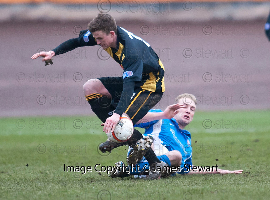 Berwick's Steven Notman is challenged by Montrose's Paul Watson.