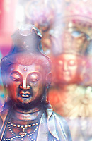 THIS PHOTO IS AVAILABLE EXCLUSIVELY FROM GETTY IMAGES.....Please search for image # a0142-000228 on www.gettyimages.com.....Buddhist Statues displayed in a store window, Chinatown, New York City, New York State, USA