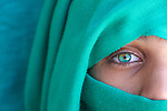 Close up Half Face covered with green of a a girl with one green eye. Photo by Sanad Ltefa