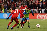 Toronto, ON, Canada - Saturday Dec. 10, 2016: Armando Cooper, Cristian Roldan, Jozy Altidore during the MLS Cup finals at BMO Field. The Seattle Sounders FC defeated Toronto FC on penalty kicks after playing a scoreless game.
