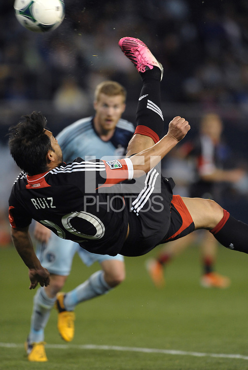 Carlos Ruiz (20) forward D.C Utd attempts an over head kick..Sporting Kansas City defeated D.C Utd 1-0 at Sporting Park, Kansas City, Kansas.