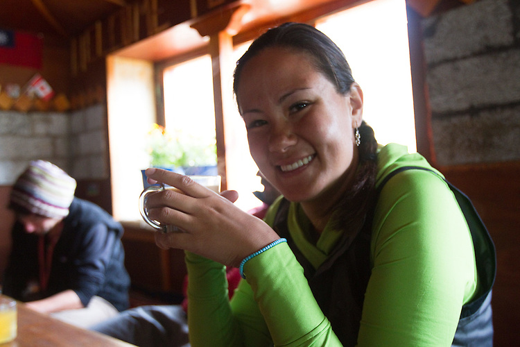 Ashley Crandall enjoys some hot tea in the town of Pheriche, Nepal at 14,000 feet.