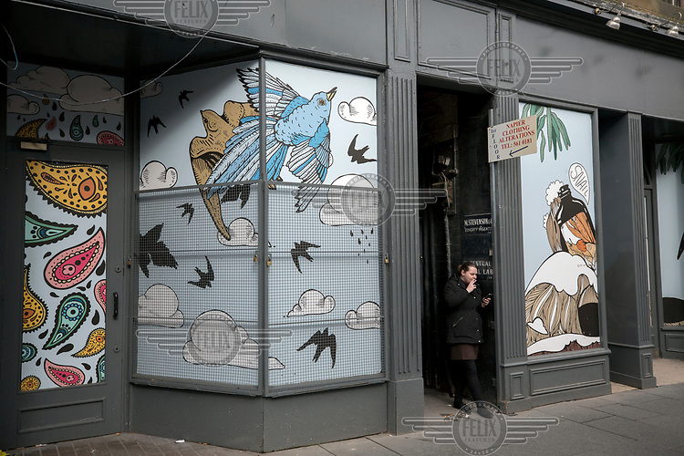 Paisley designs, among others, on the windows of a shop on the high street.