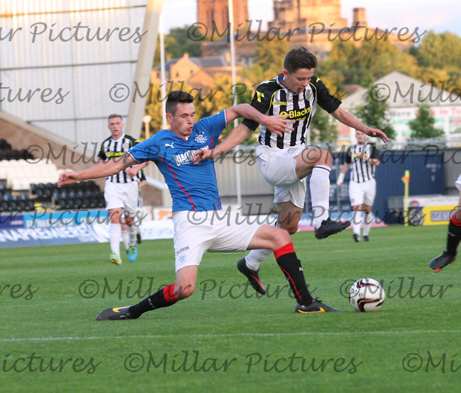 Kyle McAusland fouling Jordan Stewart in the St Mirren v Rangers Scottish Professional Football League Under 20 match played at St Mirren Park, Paisley on 10.9.13.