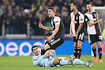 Alvaro Morata of Atletico Madrid grasps the ball after being bundled over by Matthijs De Ligt of Juventus during the UEFA Champions League match at Juventus Stadium, Turin. Picture date: 26th November 2019. Picture credit should read: Jonathan Moscrop/Sportimage