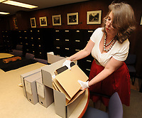 NWA Democrat-Gazette/ANDY SHUPE<br /> Catherine Wallack, architectural records archivist at the University of Arkansas and project curator for the Southland College Papers, shows a few of the photographs and documents Thursday, June 15, 2017, that are contained in the collection from the former college in rural Phillips County.