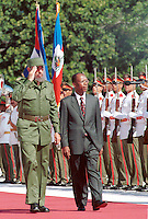 Fidel Castro receives Bertrand Aristide, President of Haiti, in the Palace of The Revolution in Havana, Cuba during a 4 day visit to Cuba. July 17, 2001.. Credit: Jorge Rey/MediaPunch