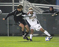 Joseph Lapira #10 of Notre Dame pulls in the ball while being challenged by Ian Daniel #21 of Oakland. The University of Notre Dame defeated Oakland University 2-1 in the second round of the NCAA championship at Alumni Field at the University of Notre Dame in South Bend, Indiana on November 28, 2007.