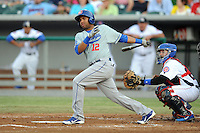 Chattanooga Lookouts third baseman Omar Luna #12 swings at a pitch during a game against the Tennessee Smokies at Smokies Park on April 10, 2013 in Kodak, Tennessee. The Lookouts won 6-2. (Tony Farlow/Four Seam Images).