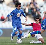 Getafe's Juan Rodriguez against Malaga's Jose Garcia Recio during La Liga Match. March 03, 2012. (ALTERPHOTOS/Alvaro Hernandez)