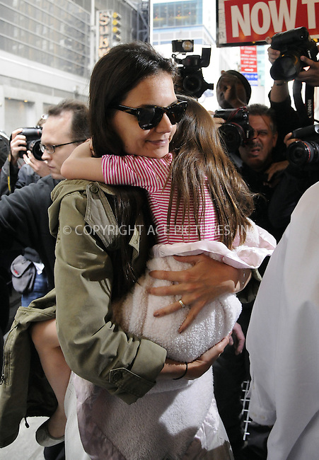 WWW.ACEPIXS.COM . . . . .  ....April 18 2012, New York City....Actress Katie Holmes took her daughter Suri Cruise to see the musical 'Newsies' and then to the American Girl Doll store on her 6th birthday on April 18 2012 in New York City....Please byline: CURTIS MEANS - ACE PICTURES.... *** ***..Ace Pictures, Inc:  ..Philip Vaughan (212) 243-8787 or (646) 769 0430..e-mail: info@acepixs.com..web: http://www.acepixs.com