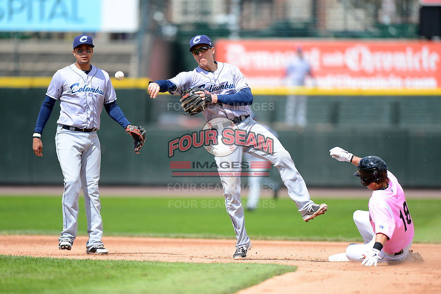 Columbus Clippers second baseman Cord Phelps #24 attempts to turn a double play as Chris Herrmann #18 slides in with Juan Diaz #13 looking on during a game against the Rochester Red Wings on May 12, 2013 at Frontier Field in Rochester, New York.  Rochester defeated Columbus 5-4.  (Mike Janes/Four Seam Images)