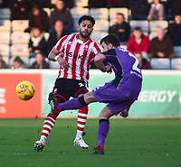 Lincoln City's Bruno Andrade vies for possession with Port Vale's James Gibbons<br /> <br /> Photographer Andrew Vaughan/CameraSport<br /> <br /> The EFL Sky Bet League Two - Lincoln City v Port Vale - Tuesday 1st January 2019 - Sincil Bank - Lincoln<br /> <br /> World Copyright &copy; 2019 CameraSport. All rights reserved. 43 Linden Ave. Countesthorpe. Leicester. England. LE8 5PG - Tel: +44 (0) 116 277 4147 - admin@camerasport.com - www.camerasport.com