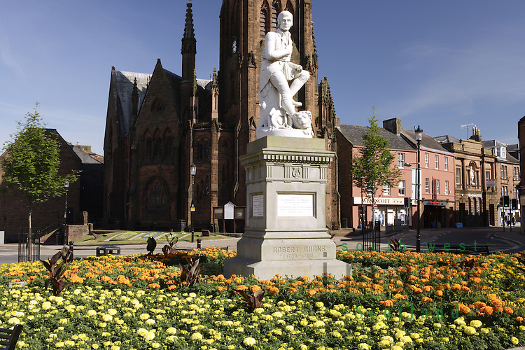 Robert Burns statue with Grey Friars Church behind in Dumfries town centre Scotland UK