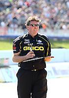 May 16, 2014; Commerce, GA, USA; A crew member for NHRA top fuel dragster driver Richie Crampton during qualifying for the Southern Nationals at Atlanta Dragway. Mandatory Credit: Mark J. Rebilas-USA TODAY Sports