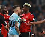 Nicolas Otamendi of Manchester City confronts Paul Pogba of Manchester United during the premier league match at the Etihad Stadium, Manchester. Picture date 7th April 2018. Picture credit should read: Simon Bellis/Sportimage