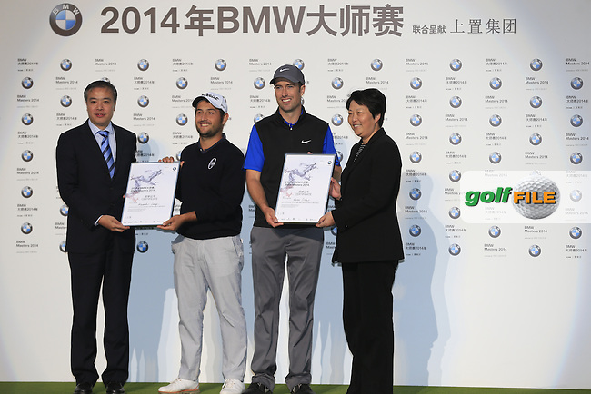 Ross Fisher (ENG) and Alexander Levy (FRA) finish joint 2nd at the end of Sunday's playoff hole in the Final Round of the 2014 BMW Masters held at Lake Malaren, Shanghai, China. 2nd November 2014.<br /> Picture: Eoin Clarke www.golffile.ie