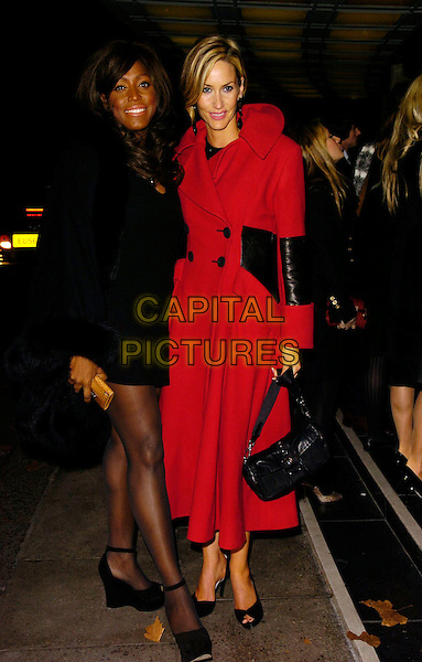 "MICA PARIS & LISA BUTCHER.Attending the UK Film Premiere of ""Blood Diamond"", .Odeon Leicester Square, London, England, .January 23rd 2007..full length red coat black dress legs wedges bag.CAP/CAN.©Can Nguyen/Capital Pictures"