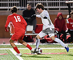 Kirkwood midfielder Peyton Boyd (left) and CBC forward Riley Dubbs vie for the ball. CBC played Kirkwood in a Class 4 sectional soccer game at Kirkwood High School in Kirkwood on Thursday November 14, 2019.<br /> Tim Vizer/Special to STLhighschoolsports.com