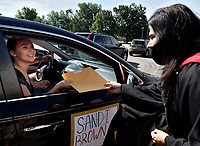 Pleasure Ridge Park High School holds their Senior Diploma Parade to distribute diplomas in a safe manor during the COVID-19 Pandemic. Teachers and staff cheered the graduates as they rode in cars through the school's parking lot to pick up their diplomas. Principal Kim Salyer handed the diplomas through car windows to the graduates.