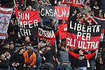 AC Milan fans in action during the Serie A football match Chievo Verona vs AC Milan at Verona, on November 10, 2013.