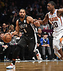 Spencer Dinwiddle #8 of the Brooklyn Nets, left, races downcourt during an NBA game against the Phoenix Suns at the Barclays Center in Brooklyn, NY on Sunday, Dec. 23, 2018. Dinwiddle scored a team-high 24 points to lead the Nets to a 111-103 win.