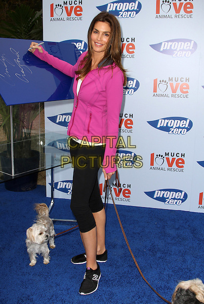 "CINDY CRAWFORD .""Propel Zero to 1000"" Celebrity Dog Walking Event  in Malibu, hosted by Cindy Crawford Held At The Church Estate Vineyards, Malibu, California, USA, 2nd April 2011..full length pink jacket  black leggings  trainers  writing dog on lead pet animal holding dogs .CAP/ADM/KB.©Kevan Brooks/AdMedia/Capital Pictures."